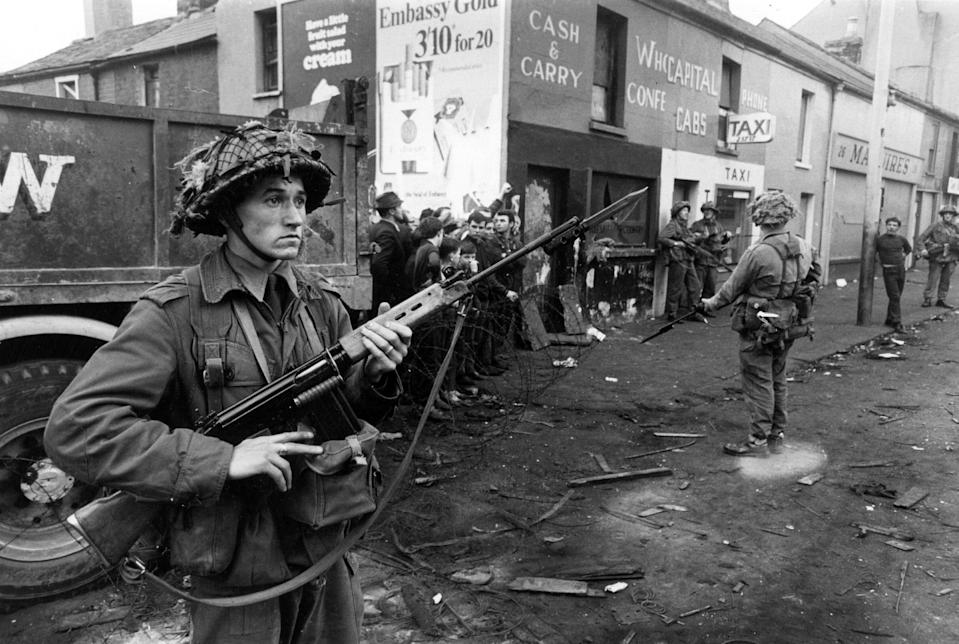 August 1969: newly arrived British soldiers on guard in the Catholic Falls Road area of BelfastGetty