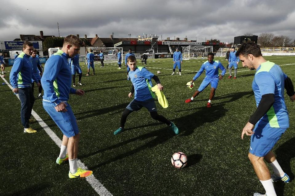 Sutton United players take part in a drill during a team training session and media day ahead of the F.A. Cup 5th round football match at The Borough Sports Ground in Sutton, sout-west London, on February 16, 2017 (AFP Photo/ADRIAN DENNIS)