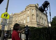 A television cameraman sets up outside the Cuban Interests Section is seen in Washington July 1, 2015. REUTERS/Gary Cameron