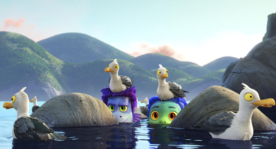 """This image released by Disney shows characters Alberto, voiced by Jack Dylan Grazer, center left, and Luca, voiced by Jacob Tremblay, as they are surrounded by seagulls in a scene from the animated film """"Luca."""" (Disney via AP)"""