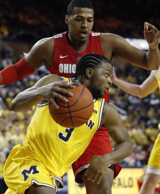Michigan guard Zavier Simpson (3) drives around Ohio State forward Kaleb Wesson during the second half of an NCAA college basketball game Tuesday, Jan. 29, 2019, in Ann Arbor, Mich. (AP Photo/Carlos Osorio)