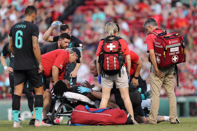 Yasser Larouci was stretchered off the field, but appears to have avoided a serious injury. (Getty Images)