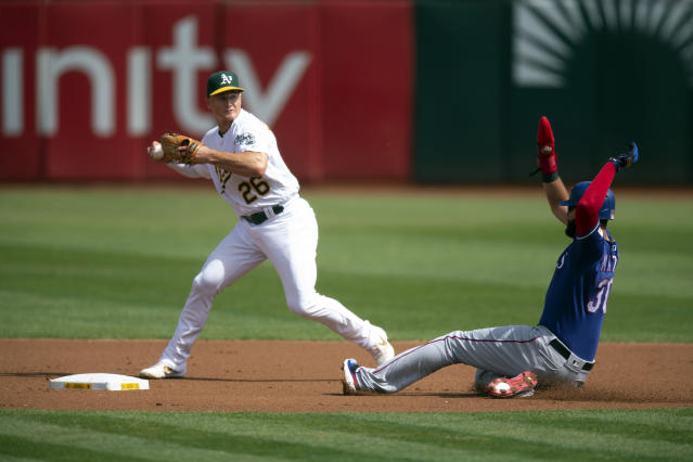 Oakland Athletics third baseman Matt Chapman (26) winds up to throw over Texas Rangers' Nomar Mazara (30) too late to complete a double play during the first inning of a baseball game, Sunday, Sept. 22, 2019, in Oakland, Calif. Rougned Odor was safe on the fielder's choice. (AP Photo/D. Ross Cameron)