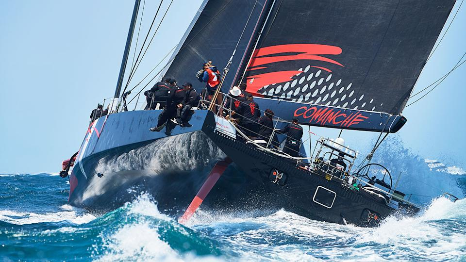 Pictured here, 2019 Sydney to Hobart line honours winner Comanche and her crew.