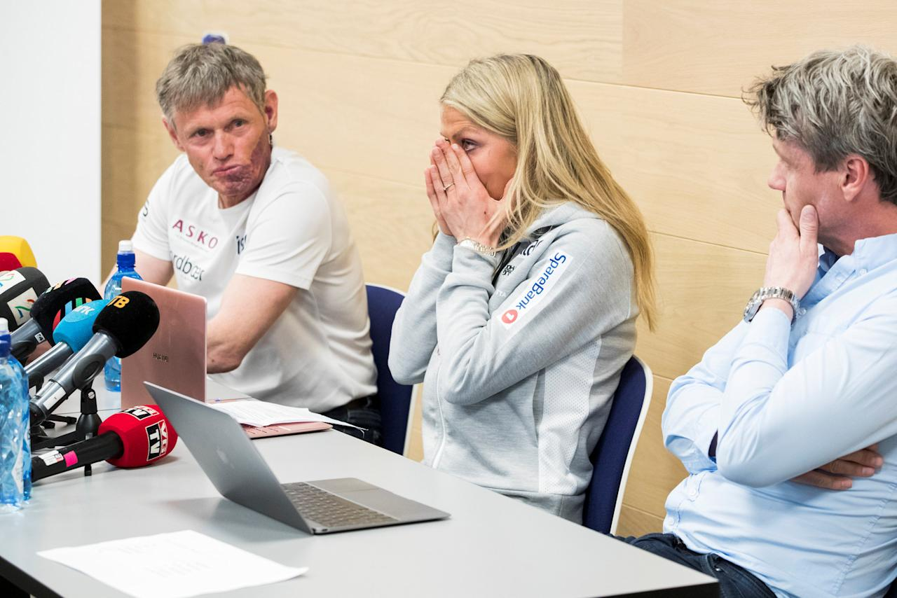 Cross country skier Therese Johaug (C) flanked by coach Pal Gunnar Mikkelsplass (L) and manager Jorn Ernst (R) during a news conference in Oslo, Norway April 19, 2018.  Johaug, a triple Olympic medalist and seven-time world champion has finished her 18-months suspension, after testing positive in September 2016 for a steroid found in a cream given to her by a team doctor to treat sunburned lips. NTB Scanpix/Hakon Mosvold Larsenn via REUTERS ATTENTION EDITORS - THIS IMAGE WAS PROVIDED BY A THIRD PARTY. NORWAY OUT. NO COMMERCIAL OR EDITORIAL SALES IN NORWAY.