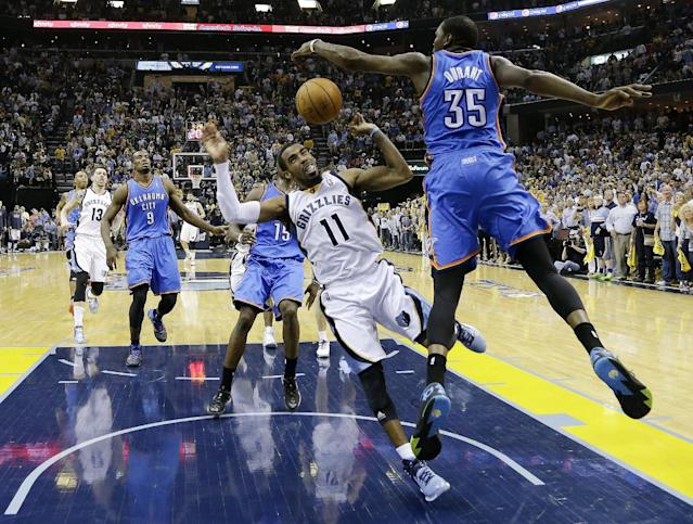 Memphis Grizzlies guard Mike Conley (11) is fouled by Oklahoma City Thunder forward Kevin Durant (35) in the second half of Game 4 of an opening-round NBA basketball playoff series Saturday, April 26, 2014, in Memphis, Tenn. Oklahoma City won in overtime 92-89. (AP Photo/Mark Humphrey)