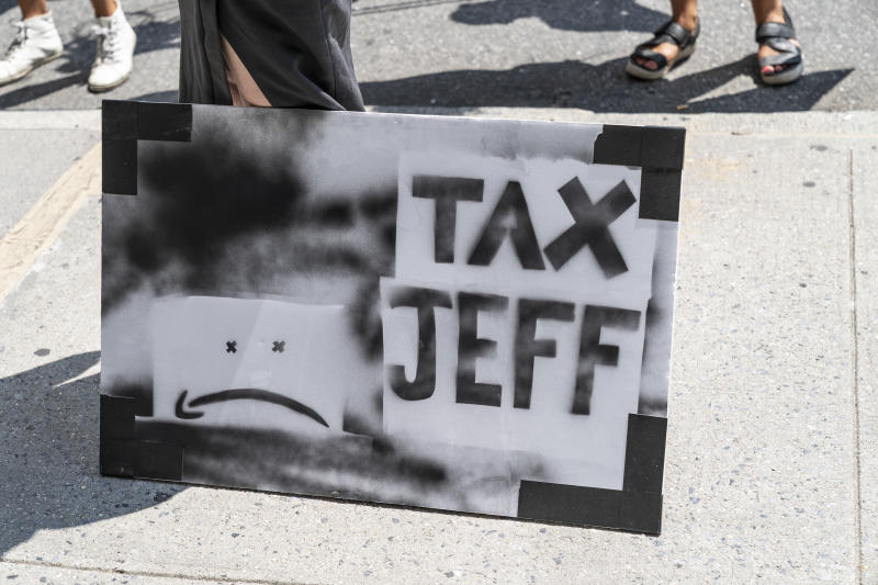 Few dozens of protesters gather in front of Jaff Bezos residency on 5th Avenue in Manhattan in New York on August 9, 2020. Protesters demand to tax rich people and in particular CEO of Amazon Jeff Bezos. (Photo by Lev Radin/Sipa USA)