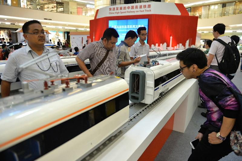 Visitors look at scale models of Chinese-made bullet trains on exhibition at a shopping mall in Jakarta (AFP Photo/Bay Ismoyo)