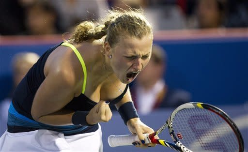 Petra Kvitova, from the Czech Republic, reacts as she faces Li Na, from China, during the final match at the Rogers Cup women's tennis tournament, Monday, Aug. 13, 2012, in Montreal. (AP Photo/The Canadian Press, Paul Chiasson)