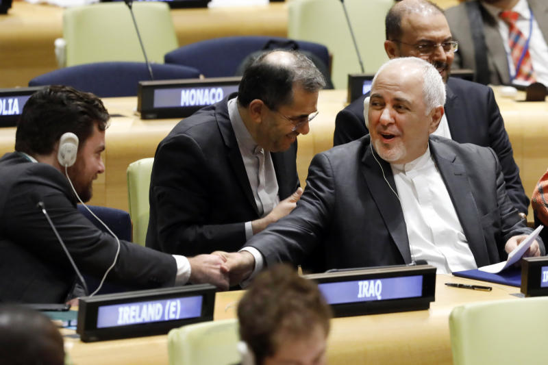 Iran's Foreign Minister Javad Zarif shakes hands with a delegate before his address to the High Level Political Forum on Sustainable Development, at United Nations headquarters, Wednesday, July 17, 2019. (AP Photo/Richard Drew)