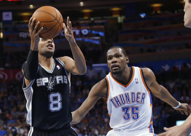 San Antonio Spurs guard Patty Mills (8) drives past Oklahoma City Thunder forward Kevin Durant (35) in the fourth quarter of an NBA basketball game in Oklahoma City, Thursday, April 3, 2014. Oklahoma City won 106-94. (AP Photo/Sue Ogrocki)