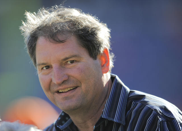"""FILE - In this Dec. 23, 2012 file photo, former Cleveland Browns quarterback Bernie Kosar stands on the sideline before of an NFL football game between the Browns and Denver Broncos, in Denver. Kosar believes he's been unfairly sacked as a TV broadcaster. Kosar contends he's been removed because of slurred speech he attributes to """"a direct result of the many concussions I received while playing in the NFL."""" (AP Photo/Jack Dempsey, File)"""