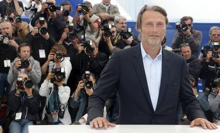 """Cast member Mads Mikkelsen poses during a photocall for the film """"Michael Kohlhaas"""" at the 66th Cannes Film Festival"""