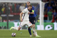 Italy's Giorgio Chiellini vies for the ball with England's Harry Kane, foreground, during the Euro 2020 soccer championship final match between England and Italy at Wembley stadium in London, Sunday, July 11, 2021. (Carl Recine/Pool Photo via AP)
