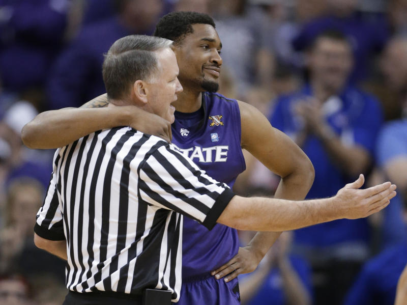 Kansas State guard Shane Southwell hugs referee Mike Stuart after a foul call during the first half against Kansas in an NCAA college basketball game for the Big 12 men's tournament title, Saturday, March 16, 2013, in Kansas City, Mo. (AP Photo/Orlin Wagner)