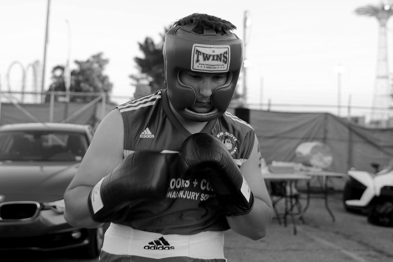 <p>Blue Glove Boxing Academy's Joe Mason warms up before his fight at the 'Brooklyn Smoker' in the parking lot of Gargiulo's Italian Restaurant in Coney Island, Brooklyn on Aug. 23, 2018. (Photo: Gordon Donovan/Yahoo News) </p>
