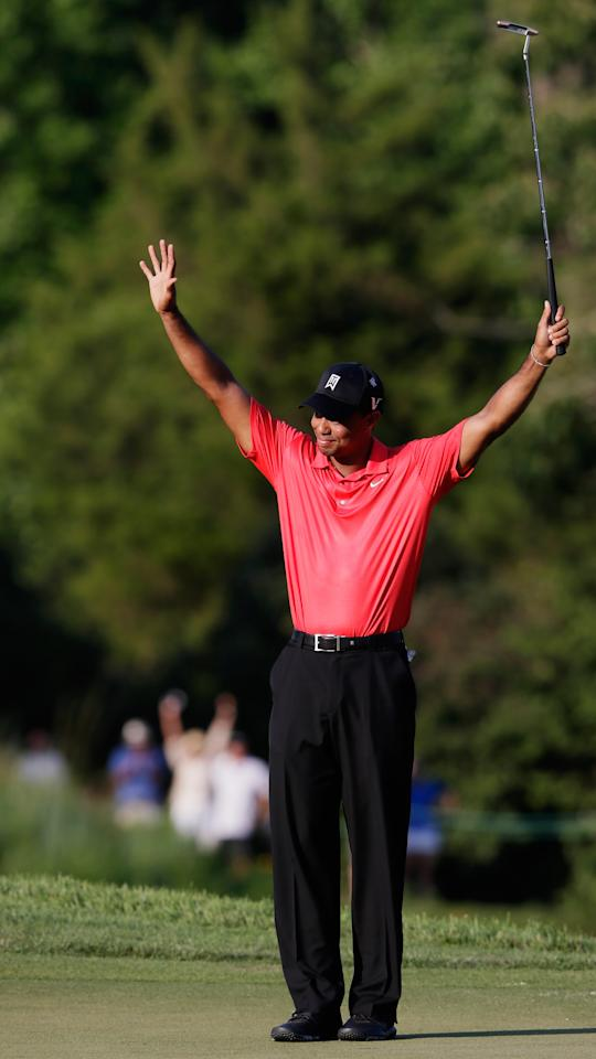 BETHESDA, MD - JULY 01: Tiger Woods celebrates on the 18th hole after winning the AT&T National at Congressional Country Club on July 1, 2012 in Bethesda, Maryland.  (Photo by Rob Carr/Getty Images)