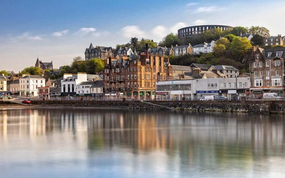 Oban's harbour, overlooked by McCaig's Tower - iStock