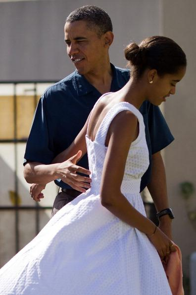U.S. President Barack Obama and his daughter Malia Obama prepare to enter the Marine Corps Base Hawaii Chapel December 25, 2011 in Kaneohe, Hawaii. Obama is spending the Christmas holiday in his native Hawaii with his family. (Photo by Kent Nishimura-Pool/Getty Images)
