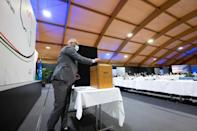 This handout picture taken by the UN shows a delegate casting his vote for the new interim government on Friday