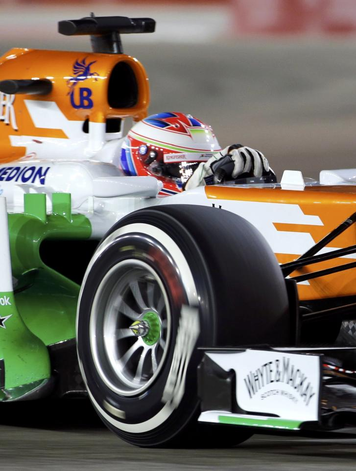 Force India Formula One driver Paul di Resta of Britain drives during the qualifying session of the Singapore F1 Grand Prix at the Marina Bay street circuit in Singapore September 21, 2013. REUTERS/Tim Chong (SINGAPORE - Tags: SPORT MOTORSPORT F1)