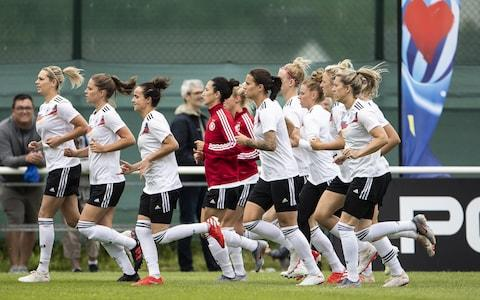 Players of Germany warm up during a traning - Credit: Getty images
