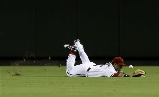 Arizona Diamondbacks' Gerardo Parra dives but is unable to catch a ball hit by Houston Astros' Jordan Schafer during the first inning in a baseball game on Friday, July 20, 2012, in Phoenix. Schafer doubled on the play and scored later in the inning. (AP Photo/Ross D. Franklin)