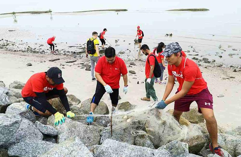 Boost employees woke up bright and early to clean trash like these annoying old fishnets from Pantai Kelanang. — Picture courtesy of Boost