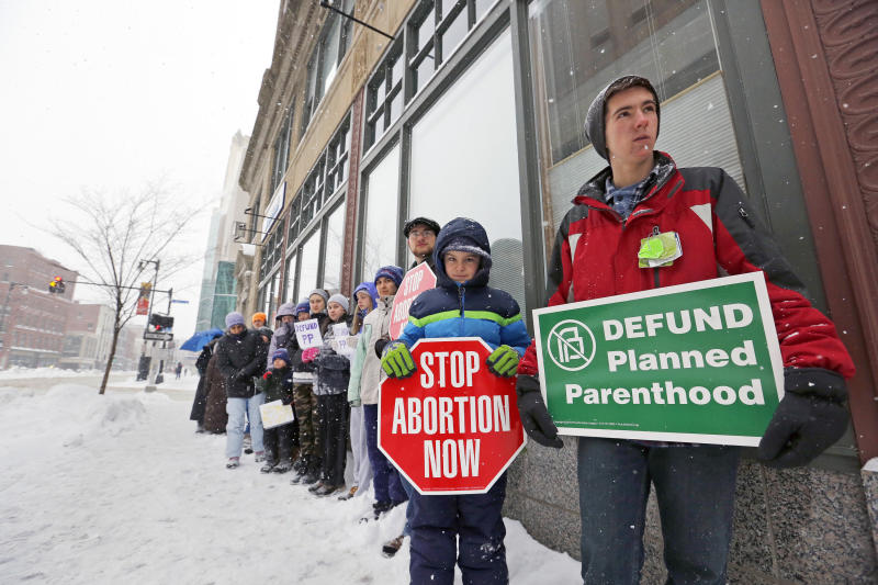 Children protest in the snow outside of Planned Parenthood's Portland, Maine clinic last Februrary. (Portland Press Herald via Getty Images)