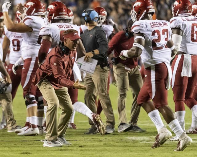 Arkansas head coach Chad Morris greet his defenders after a 4th-and-one stop of Auburn during the first half of an NCAA college football game, Saturday, Sept. 22, 2018, in Auburn, Ala. (AP Photo/Vasha Hunt)