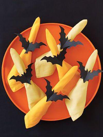 """<p>Spice up your dinner plate with these spooky napkin holders. All this design takes is black construction paper.</p><p><a href=""""https://www.womansday.com/home/crafts-projects/how-to/a5996/halloween-craft-how-to-bat-napkin-rings-123823/"""" rel=""""nofollow noopener"""" target=""""_blank"""" data-ylk=""""slk:Get the tutorial for Bat Napkin Rings."""" class=""""link rapid-noclick-resp""""><em>Get the tutorial for Bat Napkin Rings.</em></a><br></p><p><strong>What You'll need:</strong> <a href=""""https://www.amazon.com/Darice-9-Inch-by-12-Inch-Tracing-Paper-100-Sheets/dp/B004GXBXSK?tag=syn-yahoo-20&ascsubtag=%5Bartid%7C10070.g.2488%5Bsrc%7Cyahoo-us"""" rel=""""nofollow noopener"""" target=""""_blank"""" data-ylk=""""slk:Tracing paper"""" class=""""link rapid-noclick-resp"""">Tracing paper</a> ($20, Amazon); <a href=""""https://www.amazon.com/Pacon-Construction-9-Inches-12-Inches-103607/dp/B00006IDOY?tag=syn-yahoo-20&ascsubtag=%5Bartid%7C10070.g.2488%5Bsrc%7Cyahoo-us"""" rel=""""nofollow noopener"""" target=""""_blank"""" data-ylk=""""slk:Black construction paper"""" class=""""link rapid-noclick-resp"""">Black construction paper</a> ($7, Amazon)<br></p>"""