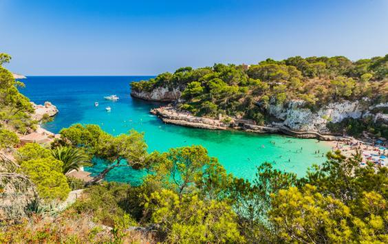 Cala Llombards has green-blue waters (Getty/iStock)