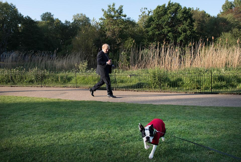 File photo dated 06/05/2020 of Prime Minister Boris Johnson taking a morning walk in St James's Park in London before returning to Downing Street. December 13th 2020 marks the first anniversary of Mr Johnson's General Election win.