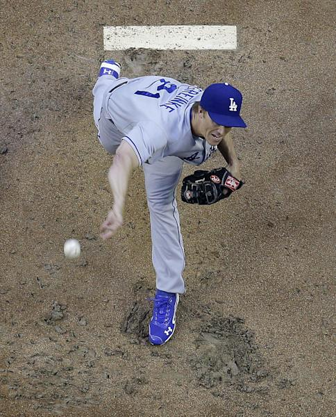 Los Angeles Dodgers pitcher Zack Greinke throws against the Arizona Diamondbacks during the first inning of a baseball game on Friday, May 16, 2014, in Phoenix. (AP Photo/Matt York)