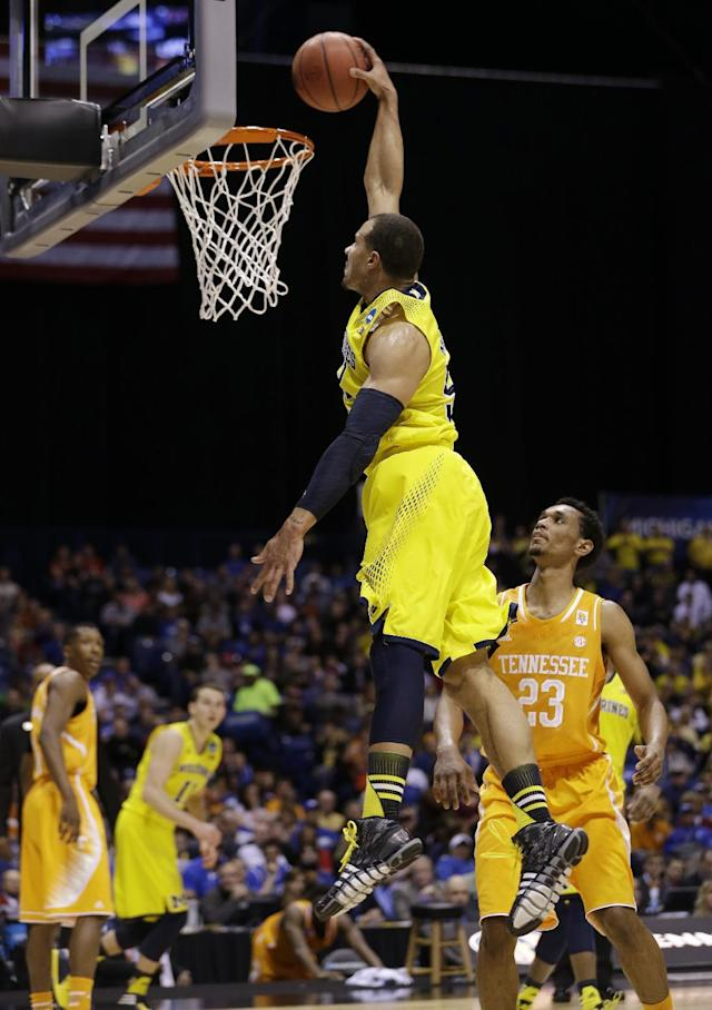 Michigan's Jordan Morgan goes up for a dunk during the first half of an NCAA Midwest Regional semifinal college basketball tournament game against the Tennessee Friday, March 28, 2014, in Indianapolis. (AP Photo/David J. Phillip)