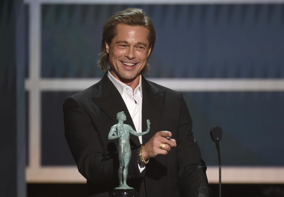 """Brad Pitt accepts the award for outstanding performance by a male actor in a supporting role for """"Once Upon a Time in Hollywood"""" at the 26th annual Screen Actors Guild Awards at the Shrine Auditorium & Expo Hall on Sunday, Jan. 19, 2020, in Los Angeles. (Photo/Chris Pizzello)"""