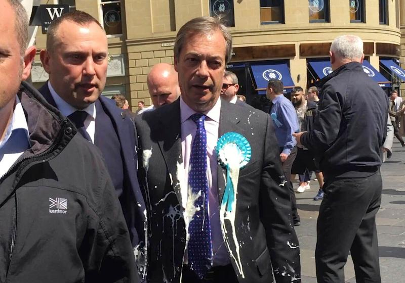 Brexit Party leader Nigel Farage after being hit with a milkshake during a campaign walkabout for the upcoming European elections in Newcastle, England, May 20, 2019. (Photo: Tom Wilkinson/PA via AP)