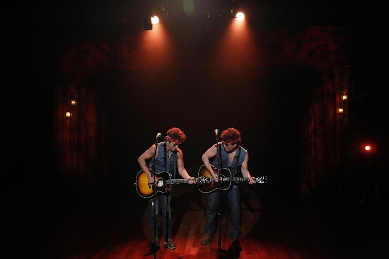 """This image released by NBC shows Bruce Springsteen, left, and Jimmy Fallon performing during """"Late Night with Jimmy Fallon,"""" on Tuesday, Jan. 14, 2014 in New York. (AP Photo/NBC, Lloyd Bishop)"""