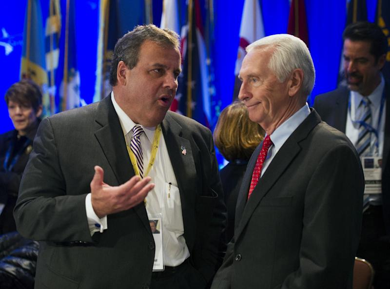 New Jersey Gov. Chris Christie, left, talks with Kentucky Gov. Steve Beshear during the National Governor's Association Winter Meeting in Washington, Saturday, Feb. 22, 2014. (AP Photo/Cliff Owen)