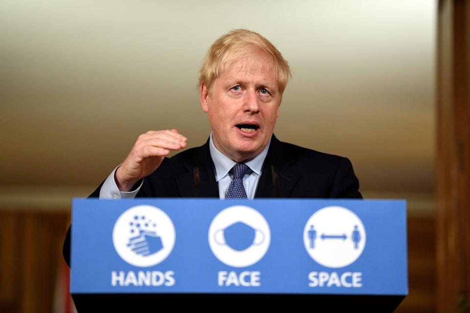 Britain's Prime Minister Boris Johnson speaks during a virtual press conference inside 10 Downing Street in central London on October 20, 2020. - British Prime Minister Boris Johnson said on Tuesday he will impose tougher coronavirus restrictions on the English city of Manchester, defying local leaders who oppose the move without greater financial help. Johnson said the city region of around 2.8 million residents would enter the highest risk category this weekend but, for the first time under a new system of localised curbs, would do so without the support its mayor and other leaders. (Photo by Leon Neal / POOL / AFP) (Photo by LEON NEAL/POOL/AFP via Getty Images)