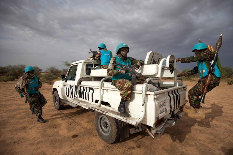 A handout picture taken on July 1, 2014 and released by UNAMID on July 2, 2014, shows UNAMID troops deployed in Khor Abeche, South Darfur, conducting a routine patrol (AFP Photo/Albert Gonzalez Farran)