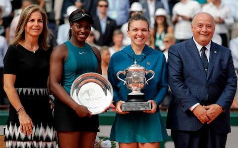 """World No 1 Simona Halep finally broke her grand-slam jinx at Roland Garros, producing an unforgettable comeback to burn past the reigning US Open champion Sloane Stephens on the home straight. The fans in Paris had watched Halep come up just short of the title here twice before, and they have developed a warm relationship with her. Court Philippe Chatrier was rocking in the third set as Halep pulled away, producing some absurd recovery shots to exhaust the waning Stephens further. At the close of her 3-6, 6-4, 6-1 win, Halep accepted a leg-up from a courtside official and climbed up to her player box, where she embraced the three men who have stood consistently at her side through her climb up the world rankings: physio Andrei Cristofor, fitness trainer Teo Cercel and coach Darren Cahill. As the Telegraph reported, in a pre-tournament interview with Halep: """"I have people around me who are friends and I feel like they are there forever."""" This comeback was surely all the sweeter because Halep was thoroughly outplayed in the opening set. Stephens was so smooth and so resourceful, mixing booming topspin with flatter, faster strikes in a way that made her look – for 40 minutes or so – virtually unbeatable. The apparent rout continued into the early stages of the second, as Stephens broke again to lead 6-3, 2-0. The scoreline then was curiously similar to the lead that Halep had held over Jelena Ostapenko here 12 months ago. Halep celebrates winning the French Open Credit: AP Halep wound up as the frustrated party that day, backing off at just the wrong moment and allowing the free-swinging Ostapenko to surge to a shock win. But she is never more dangerous than when she is trailing, because that is when she loosens up and starts playing like a woman with nothing to lose. """"I thought 'Everything is gone. I just have to relax,'"""" said Halep afterwards, grinning her way through her on-court interview, as she remembered the key moment. The switch was partly spiritual, as she ta"""