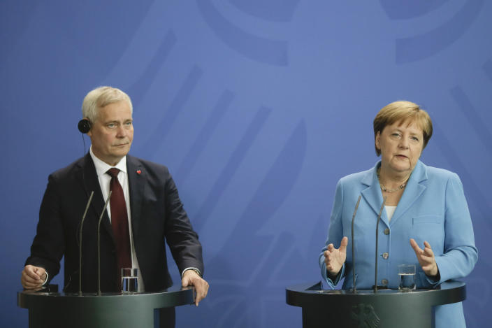 German Chancellor Angela Merkel, right, and the Prime Minister of Finland Antti Rinne brief the media after a meeting at the chancellery in Berlin, Wednesday, July 10, 2019. (AP Photo/Markus Schreiber)
