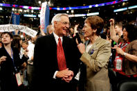 FILE - In this Monday, July 26, 2004, file photo, former Vice President Walter Mondale smiles with his wife, Joan, in the Minnesota delegation during the Democratic National Convention at the FleetCenter in Boston. Mondale, a liberal icon who lost the most lopsided presidential election after bluntly telling voters to expect a tax increase if he won, died Monday, April 19, 2021. He was 93. (AP Photo/Amy Sancetta, File)