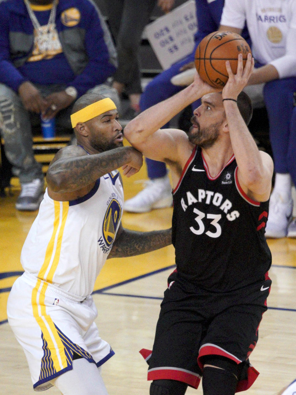 Toronto Raptors center Marc Gasol (33) shoots against Golden State Warriors center DeMarcus Cousins during the first half of during Game 3 of basketball's NBA Finals in Oakland, Calif., Wednesday, June 5, 2019. (AP Photo/Tony Avelar)