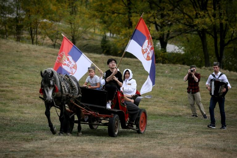 In the rural western Serbian holiday village of Gostoljublje, owner Zeljko Sredic says he chose to lay on weddings for tourists because they include Serbian customs in food, song, dance and costume (AFP Photo/OLIVER BUNIC)