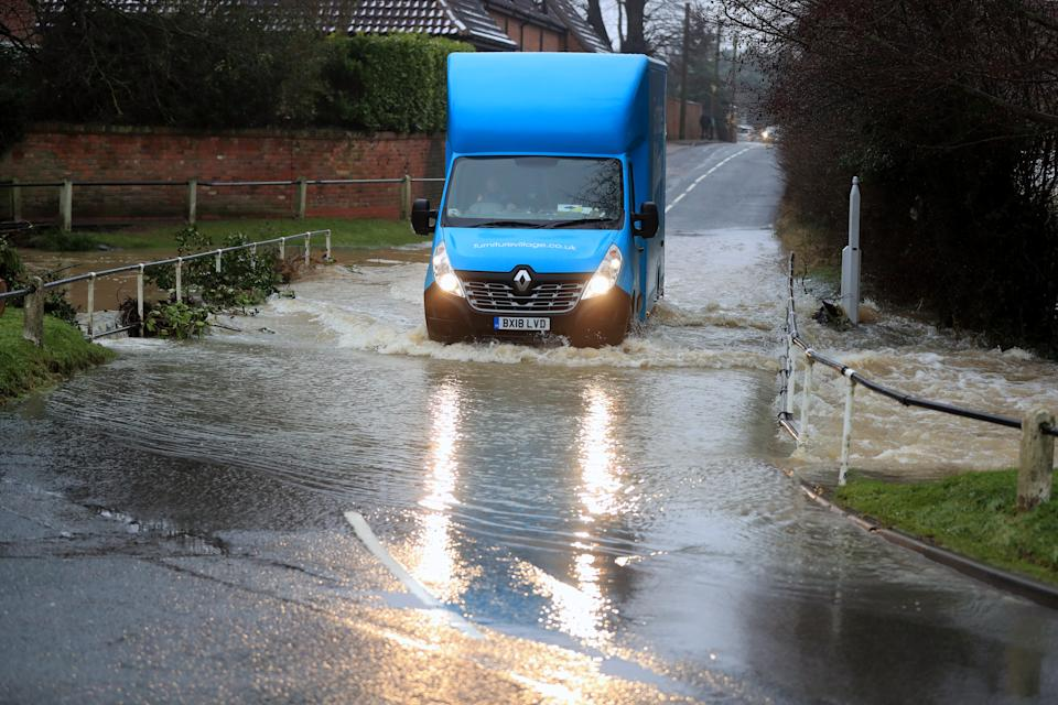 A van on a flooded road in Bottesford, Leicestershire. Heavy snow and freezing rain is set to batter the UK this week, with warnings issued over potential power cuts and travel delays. (Photo by Mike Egerton/PA Images via Getty Images)