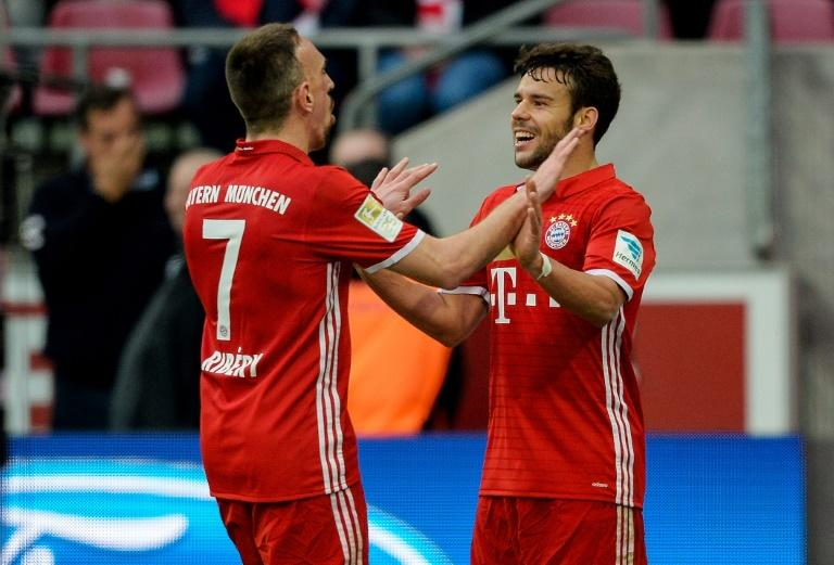 Bayern Munich's midfielder Franck Ribery (L) celebrates his 0-3 goal with defender Juan Bernat during the German First division Bundesliga football match against Cologne March 4, 2017