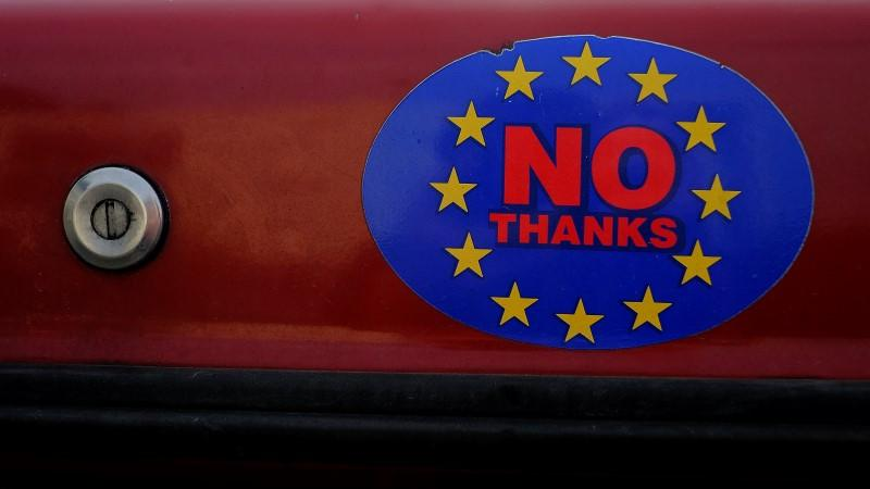 A car sticker with a logo encouraging people to leave the EU is seen on a car, in Llandudno, Wales.