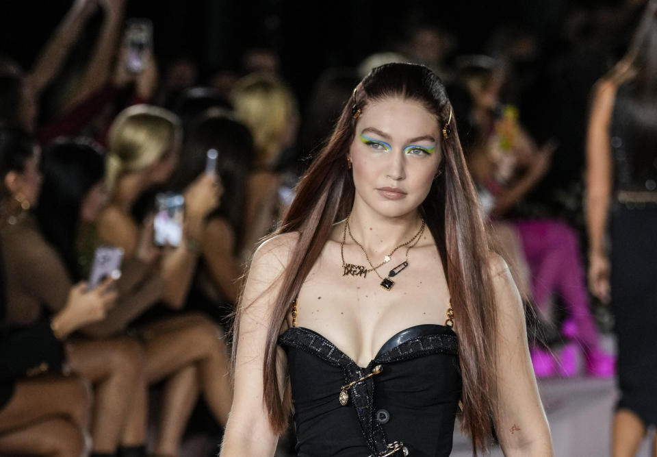 Gigi Hadid wears a creation for the Versace Spring Summer 2022 collection during Milan Fashion Week, in Milan, Italy, Friday, Sept. 24, 2021. (AP Photo/Luca Bruno)